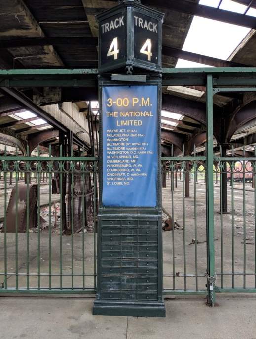 antique railroad destination track sign