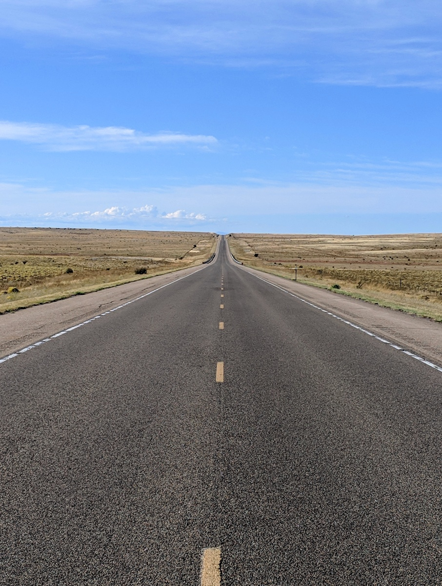 long empty road in Texas leading to the horizon